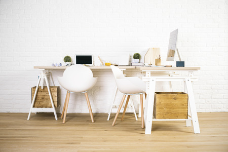 office wall: Front view of interior with creative workplace, wooden floor and white brick wall Stock Photo
