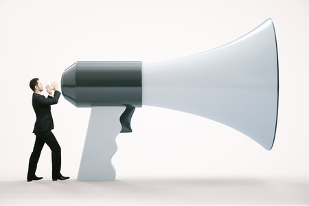 huge: Small businessman screaming into huge megaphone on white background. 3D Rendering Stock Photo