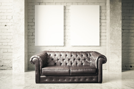 leather couch: Luxurious black leather couch and two blank posters on white brick wall background. Mock up, 3D Rendering Stock Photo