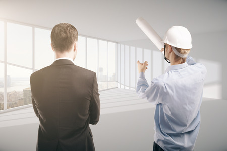 home inspector: engineer and businessman standing in room. 3D Rendering Stock Photo