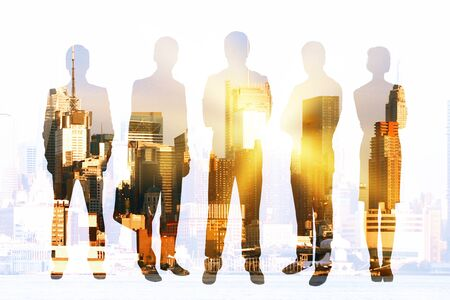 Businesspeople silhouettes on city background with sunlight. Concept of teamwork and partnership. Double exposure Stock Photo