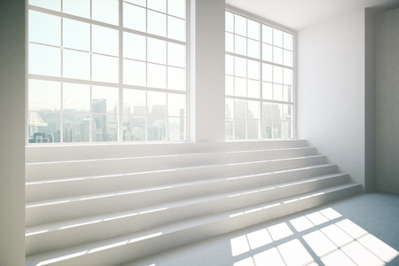 daylight: Side view of concrete interior with stairs, daylight and windows with city view. 3D Rendering Stock Photo
