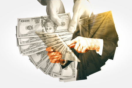 Businesspeople holding dollars and using tablet. Success concept. Double exposure Stock Photo