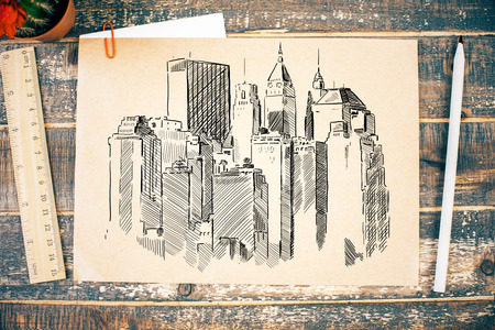 construction project: Construction sketch on aged wooden desktop with ruler, pencil and cactus