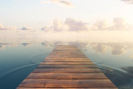 sea dock: Wooden plank sea pier on beautiful sky background. 3D Rendering
