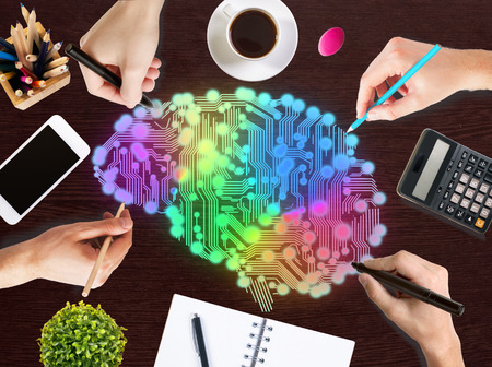 brain storm: Creative thinking concept with hands drawing abstract colorful digital human brain on wooden office desktop with blank smartphone, coffee cup, stationery items, calculator and decorative plant