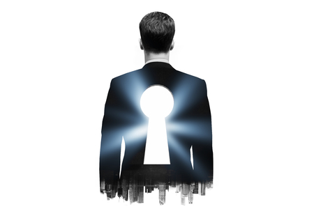 key to freedom: Businessman with keyhole in his back on dark city background. Double exposure