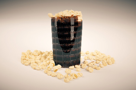 scattered in heart shaped: Movie lovers concept with film strip popcorn cup on light background. 3D Rendering