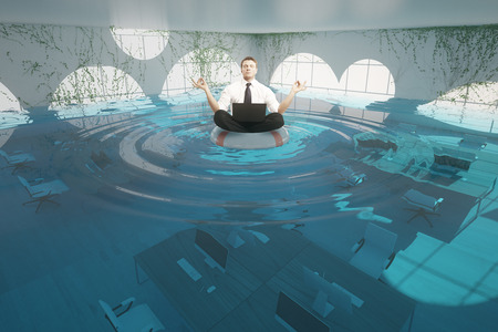 Businessman with laptop meditating on lifebuoy in abstract flooded office interior. 3D Rendering