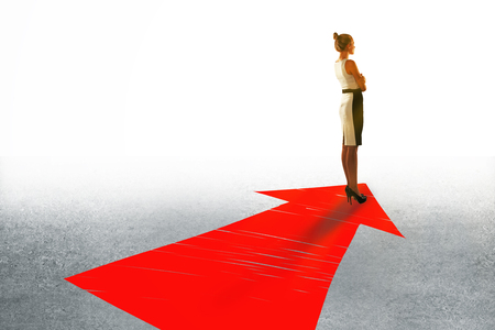 target thinking: Success concept with businesswoman standing on large red arrow Stock Photo