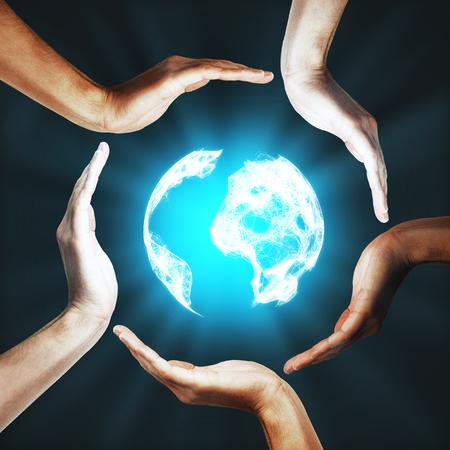 illuminated: International global business concept. Human hands of different races around illuminated digital globe Stock Photo