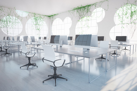 Bright clean coworking office interior with computers, round windows and plants all over walls. 3D Rendering Stock Photo