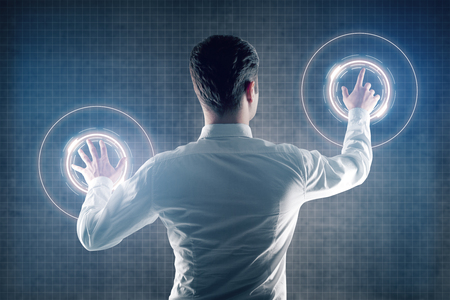 office man: Back view of businessman managing digital interface on grid background