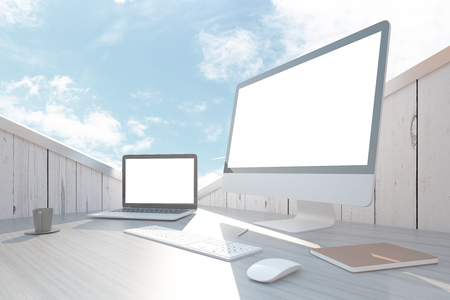 laptop outside: Closeup of abstract wooden workplace with blank white laptop and computer screens, keyboard, mouse, book and coffee cup under bright blue sky. Mock up