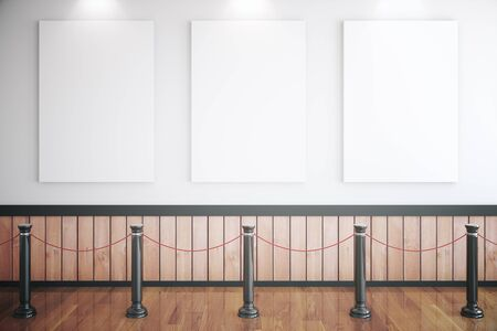 railings: Museum interior with three blank posters, railings and wooden floor. Mock up, 3D Rendering Stock Photo