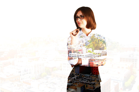 double chin: Thoughtful businesswoman on city background with copyspace. Double exposure Stock Photo