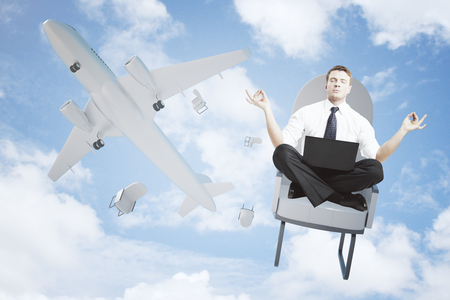 falling out: Meditating man with laptop falling out of airplane on bright blue sky background Stock Photo