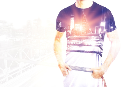Body of young casual man on city background with abstract light. Double exposure