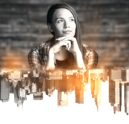Thoughtful young woman with abstract upside down city reflection Stock Photo