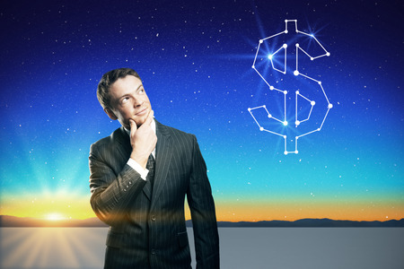 Confident businessman thinking about cash on beautiful background with stars in the sky, landscape and sunset Stock Photo