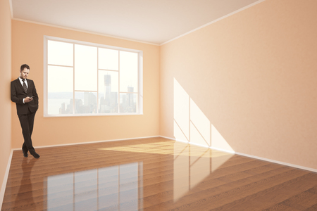 shiny floor: Businessman using smartphone in interior with shiny wooden floor, concrete walls, window with city view and daylight. 3D Rendering