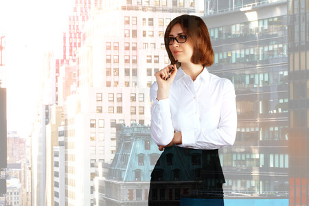 double chin: Thinking businesswoman on city background with copyspace. Double exposure Stock Photo