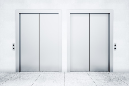 stainless: Front view of two elevators in light concrete interior. 3D Rendering Stock Photo