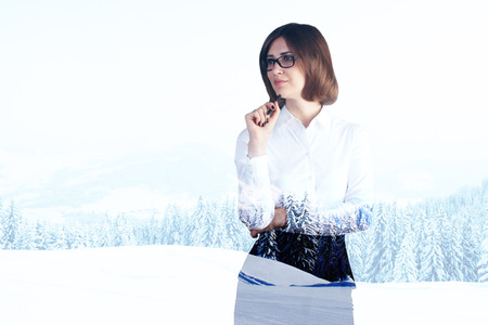 double chin: Pondering businesswoman on snowy landscape background with copyspace. Double exposure