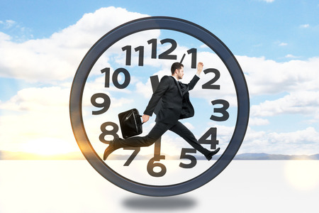 rushing hour: Businessman with briefcase running inside clock on sky background with sunlight.