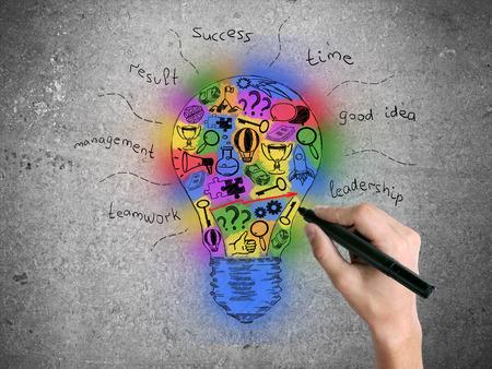 idea sketch: Hand drawing creative colorful lightbulb sketch on concrete wall. Idea concept