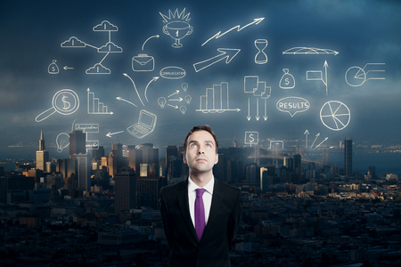 Businessman looking up at abstract business sketch on city background
