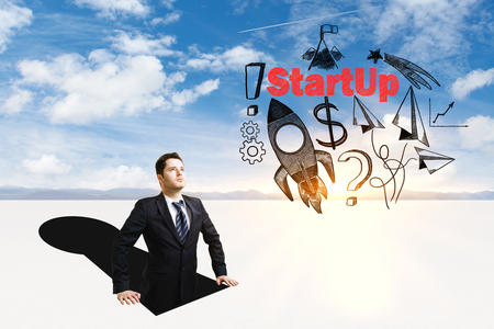 Businessman inside abstract keyhole looking at rocket ship sketch on sky background. Start up concept