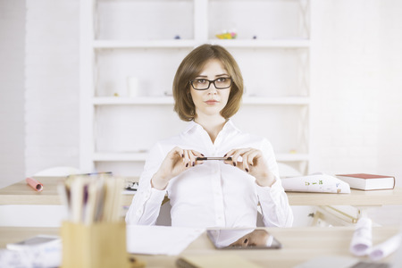 modern businesswoman: Portrait of concentrated businesswoman looking into the distance in modern office interior Stock Photo