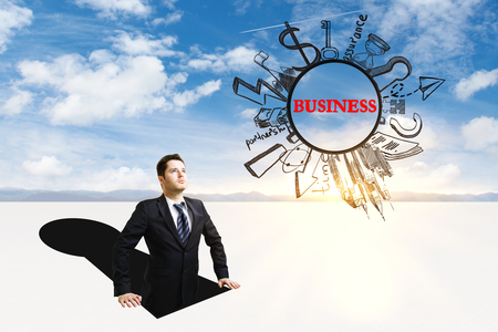 Businessman inside abstract keyhole looking at business sketch on sky background Stock Photo
