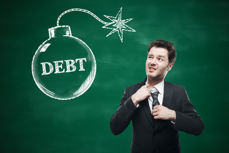 choking: Debt concept with choking businessman and sketch on chalkboard background