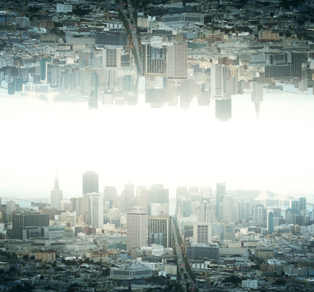 Abstract reflected upside down city on light backgrounf Stock Photo