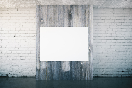 wooden panel: White brick interior with blank poster on dark wooden panel. Mock up, 3D Rendering Stock Photo