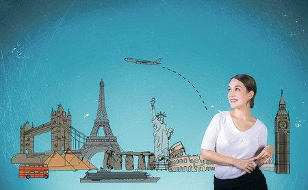 charming: Traveling concept with charming young lady with sketch on blue background Stock Photo