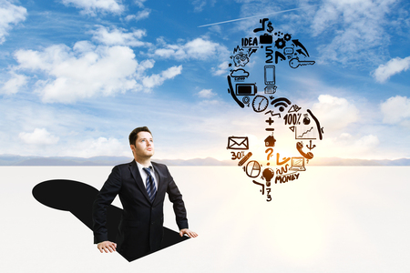 Businessman inside abstract keyhole looking at dollar sign sketch on sky background Stock Photo