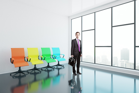 view window: Businessman with briefcase and colorful swivel chairs in interior with glossy concrete floor and panoramic window with city view. Side view, 3D Rendering