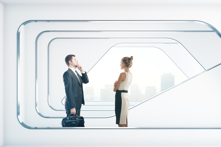 futuristic interior: Thoughtful businessman and woman in abstract futuristic interior with city view