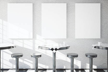 textured wall: Iron tables and chairs in cafe dining area with three blank posters on textured concrete wall. Mock up, 3D Rendering