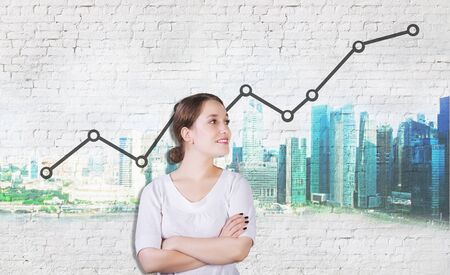 white wall: Attractive young womanstanding against white brick wall with city sketch and profit growth line chart. Success concept