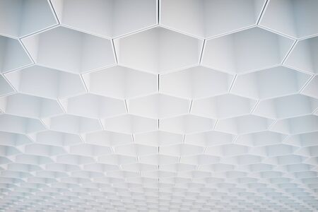 voluminous: Abstract white honeycombhexagon pattern on ceiling. Background or wallpaper. 3D Rendering Stock Photo