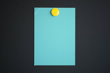 note pad: Blue paper sheet with yellow button magnet on dark background. Mock up, 3D Rendering Stock Photo