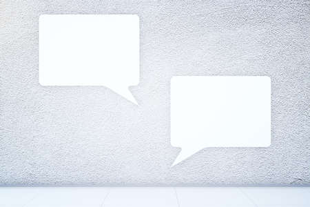 chat room: Two big speech bubbles in textured concrete room. Communication concept. Mock up, 3D Rendering