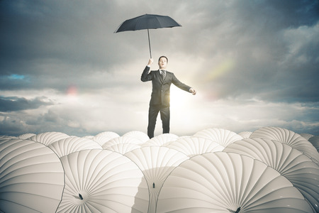stormy sky: Businessperson with white umbrellas on stormy sky background. Business protection concept. 3D Rendering