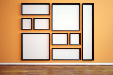 wooden floor: Front view of multiple blank picture frames in interior with orange wallpaper and wooden floor. Mock up, 3D Rendering Stock Photo