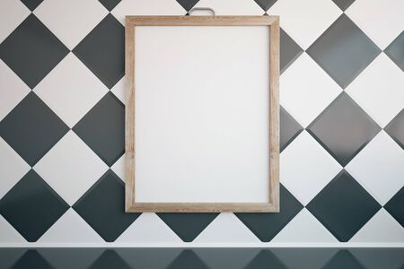 plinth: Front view of blank picture frame hanging on chessboard patterned wall in room. Mock up, 3D Rendering Stock Photo