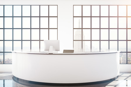 panoramic windows: Modern reception desk with computer monitor in interior with panoramic windows and New York city view. 3D Rendering Stock Photo